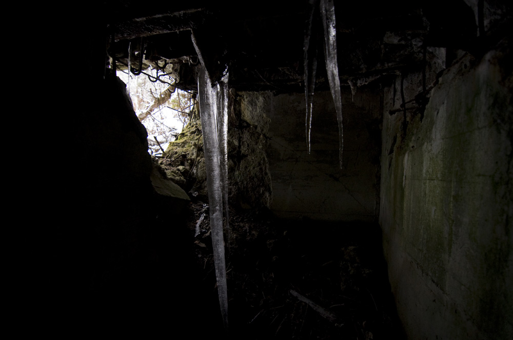 Ice inside a blown up personnel bunker type 10 near Ormont